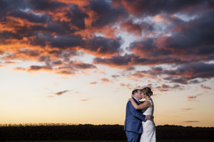 Groom and Bride under Beautiful Sky